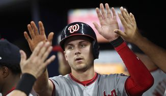 Washington Nationals shortstop Trea Turner (7) celebrates after scoring on a Ryan Zimmerman base hit in the third inning of a baseball game against the Atlanta Braves Tuesday, Sept. 19, 2017, in Atlanta. (AP Photo/John Bazemore)
