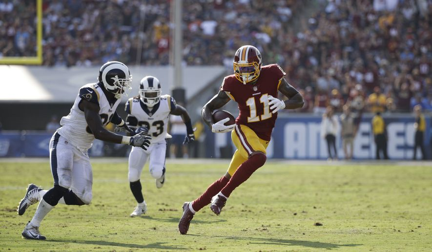 Washington Redskins' Terrelle Pryor carries the ball during an NFL football game against the Los Angeles Rams Sunday, Sept. 17, 2017, in Los Angeles. (AP Photo/Jae C. Hong)