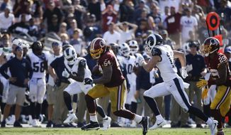 Washington Redskins inside linebacker Mason Foster carries the ball for a touchdown during an NFL football game against the Los Angeles Rams Sunday, Sept. 17, 2017, in Los Angeles. (AP Photo/Jae C. Hong) **FILE**