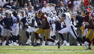 Washington Redskins inside linebacker Mason Foster carries the ball for a touchdown during an NFL football game against the Los Angeles Rams Sunday, Sept. 17, 2017, in Los Angeles. (AP Photo/Jae C. Hong)