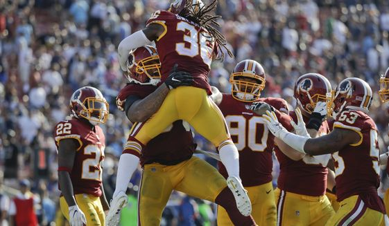 Washington Redskins inside linebacker Mason Foster(54) celebrates his touchdown with D.J. Swearinger during an NFL football game against the Los Angeles Rams Sunday, Sept. 17, 2017, in Los Angeles. (AP Photo/Jae C. Hong)