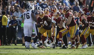 Washington Redskins inside linebacker Mason Foster(54) celebrates his touchdown with teammates during an NFL football game against the Los Angeles Rams Sunday, Sept. 17, 2017, in Los Angeles. (AP Photo/Jae C. Hong) **FILE**
