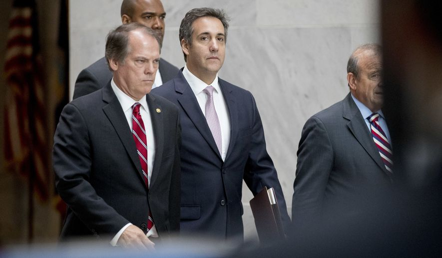 President Donald Trump's lawyer Michael Cohen, center, departs following a closed door meeting with the Senate Intelligence Committee on Capitol Hill, Tuesday, Sept. 19, 2017, in Washington. (AP Photo/Andrew Harnik)