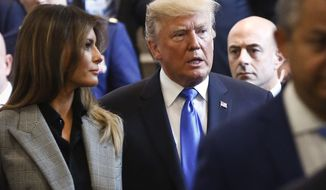 U.S. President Donald Trump, center, and first lady Melania Trump, left, leaves after his address to the United Nations General Assembly, Tuesday Sept. 19, 2017, at U.N. headquarters. (AP Photo/Bebeto Matthews)