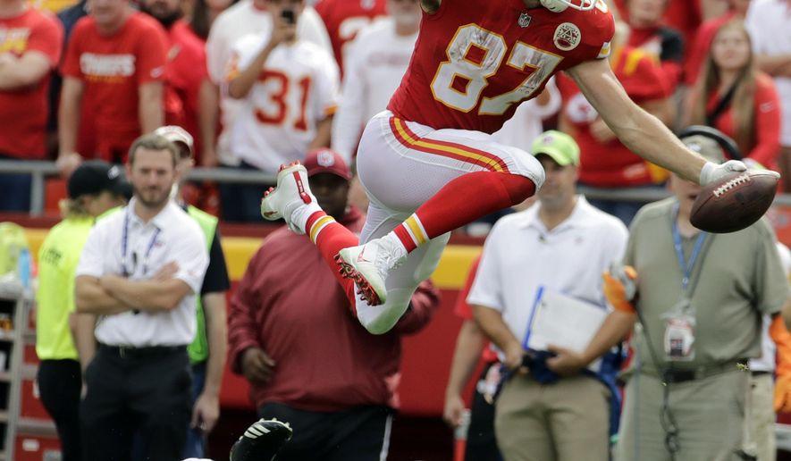 Kansas City Chiefs tight end Travis Kelce (87) vaults over Philadelphia Eagles cornerback Rasul Douglas (32) during the second half of an NFL football game in Kansas City, Mo., Sunday, Sept. 17, 2017. (AP Photo/Charlie Riedel)