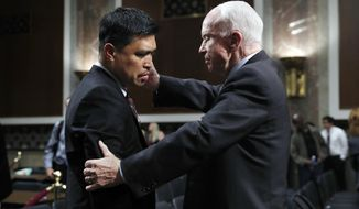 Senate Armed Services committee chairman Sen. John McCain, R-Ariz., right, comforts Victor Sibayan, of Chula Vista, Calif., whose son, Navy FC1(SW) Carlos Sibayan, 23, died in the USS Fitzgerald collision, after a hearing on recent Navy incidents, Tuesday, Sept. 19, 2017, on Capitol Hill in Washington. (AP Photo/Jacquelyn Martin)