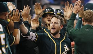 Oakland Athletics' Jed Lowrie celebrates hitting a grand slam against the Detroit Tigers in the eighth inning of a baseball game in Detroit, Tuesday, Sept. 19, 2017. (AP Photo/Paul Sancya)