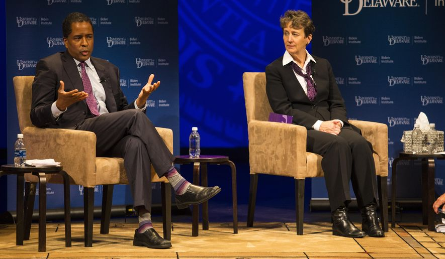President and Co-founder of Opportunity@Work Byron Auguste, left, and President of the Services Employees International Union Mary Kay Henry speak during a roundtable discussion on job creation and the economy Tuesday, Sept. 19, 2017, at the University of Delaware in Newark, Del. (Jerry Habraken/The Wilmington News-Journal via AP)