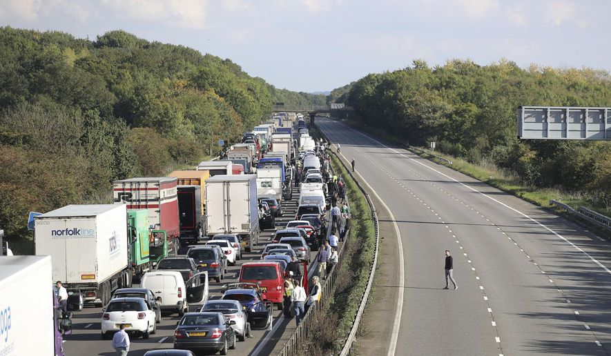 """The M1 is seen with three carriageways closed after an incident near Milton Keynes, England, Tuesday, Sept. 19, 2017. Hundreds of motorists were stuck for hours on one of Britain's main highways after it was closed Tuesday due to a """"suspicious object.""""  The M1 motorway was shut along a 10 mile (16 kilometer) stretch near Milton Keynes, about 50 miles (80 kilometers) north of London, after the object was found under a bridge at around 7:30 a.m., Thames Valley Police said. (Steve Parsons/PA via AP)"""