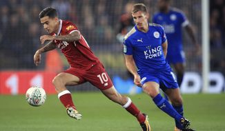 Liverpool's Philippe Coutinho, left, and Leicester City's Marc Albrighton battle for the ball during their English League Cup, third round soccer match at the King Power Stadium, Leicester, England, Tuesday, Sept. 19, 2017. (Mike Egerton/PA via AP)