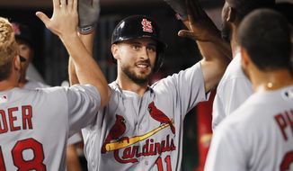 St. Louis Cardinals' Paul DeJong (11) celebrates in the dugout after hitting a solo home run off Cincinnati Reds starting pitcher Jackson Stephens in the fourth inning of a baseball game, Tuesday, Sept. 19, 2017, in Cincinnati. (AP Photo/John Minchillo)