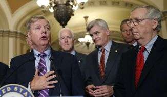 Sen. Lindsey Graham, R-S.C., speaks to the media, accompanied by Senate Majority Whip Sen. John Cornyn, R-Texas, Sen. Bill Cassidy, R-La., Sen. John Thune, R-S.D., and Senate Majority Leader Mitch McConnell of Ky., on Capitol Hill, Tuesday, Sept. 19, 2017, in Washington. (AP Photo/Alex Brandon)