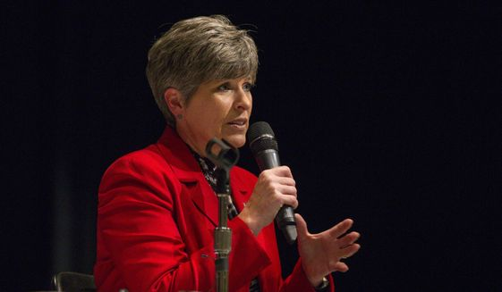 Republican Sen. Joni Ernst holds a town hall meeting in Fort Dodge, Iowa, Monday, Aug. 14, 2017. (Rodney White/The Des Moines Register via AP) ** FILE **