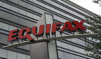 This Saturday, July 21, 2012, photo shows signage at the corporate headquarters of Equifax Inc. in Atlanta. (AP Photo/Mike Stewart)