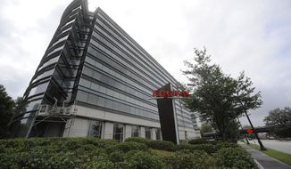 This Saturday, July 21, 2012, photo shows the corporate headquarters of Equifax Inc. in Atlanta. New York Attorney General Eric Schneiderman is pressing credit monitoring companies TransUnion and Experian to explain what cybersecurity they have in place to protect sensitive consumer information following a breach at Equifax, discovered by the company in July 2017, that exposed the data of 143 million Americans. (AP Photo/Mike Stewart)