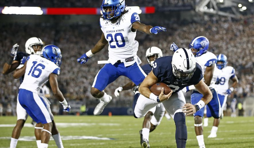 Penn State's Tommy Stevens (2) dives in for a touchdown against Georgia State during the first half of an NCAA college football game in State College, Pa., Saturday, Sept. 16, 2017. (AP Photo/Chris Knight)