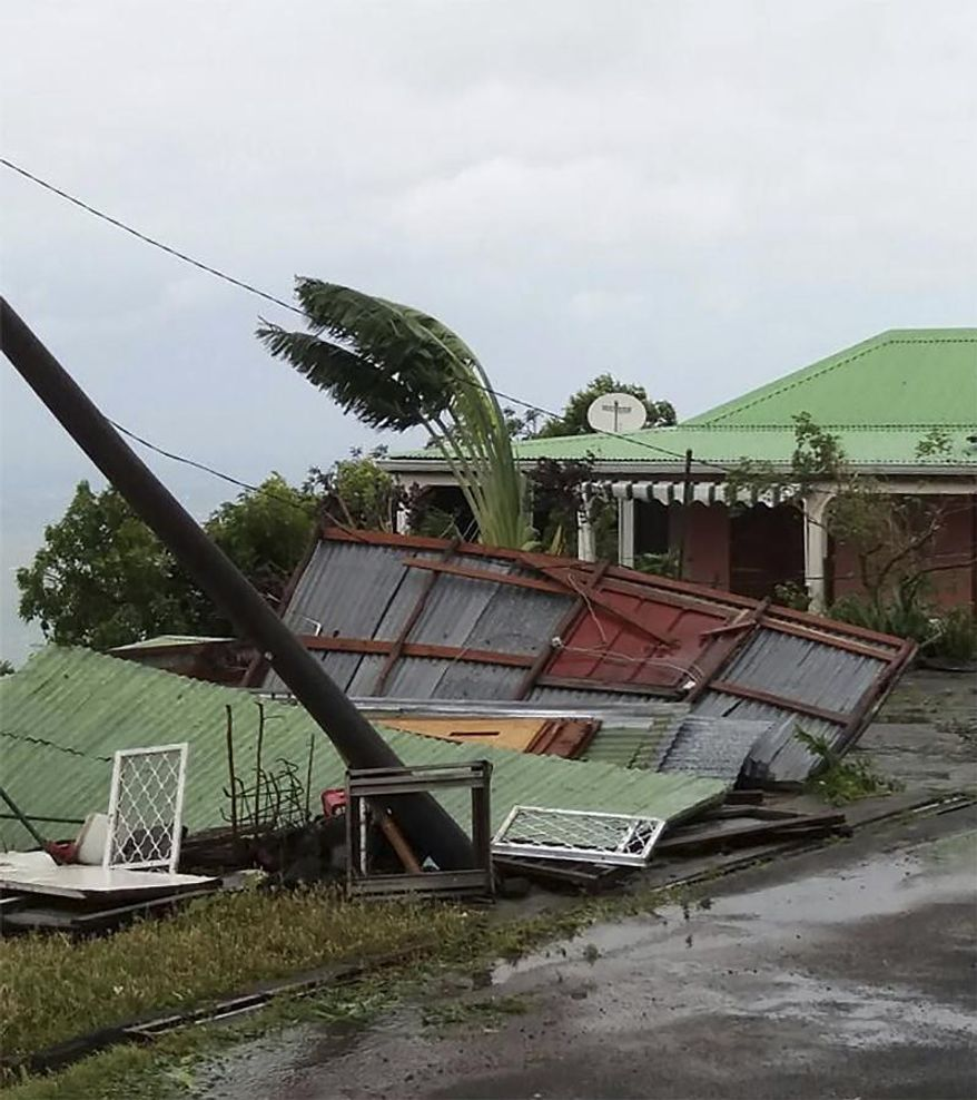 This photo provided by Jenny Promeneur shows storm damage to her grandmother's tool shed/dog house, caused by Hurricane Maria in Bouillante, Guadeloupe, Tuesday, Sept. 19, 2017. (Jenny Promeneur via AP)