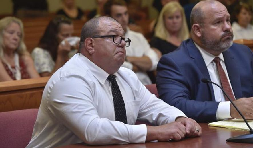 Missouri Highway Patrol trooper Anthony Piercy, left, appears in court as he is sentenced on Tuesday, Sept. 19, 2017, in Versailles, Mo. Piercy will spend 10 days in jail and two years on supervised probation for the death of a handcuffed man who drowned when he fell out of the trooper's boat. (Keith Myers/The Kansas City Star via AP)