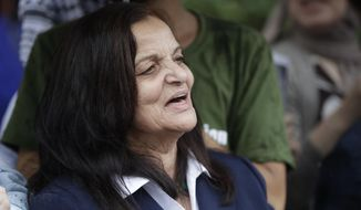 FILE - In this Aug. 17, 2017 file photo, Palestinian activist Rasmea Odeh of Chicago, stands outside the Theodore Levin U.S. Courthouse in Detroit, Mich., for a final court hearing before she's eventually deported. Supporters say the activist is leaving the U.S. for Jordan, after a criminal case that revealed her decades-old record of bombings in Jerusalem. Odeh will leave Chicago's O'Hare International Airport for Jordan on Tuesday Sept. 19, 2017. Supporters plan to gather at the airport's international terminal with signs and banners before she leaves. (AP Photo/Carlos Osorio File)