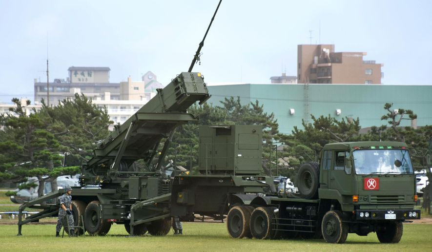 Patriot Advanced Capability-3 interceptor missile system (PAC3) is deployed at the Hakodate base of Japan's Self-Defense Forces Tuesday, Sept. 19, 2017 in Hakodate, northern Japan.  Japan is moving a mobile missile-defense system on the northern island of Hokkaido to a base near recent North Korean missile flyover routes. (Kyodo News via AP)