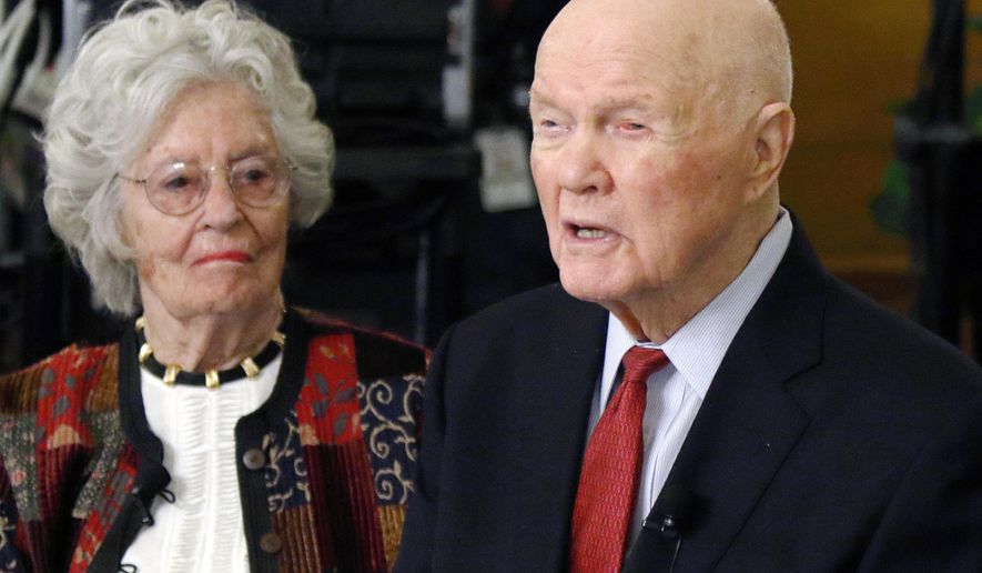 FILE - In this May 14, 2015, file photo, former astronaut and U.S. Sen. John Glenn, right, speaks beside his wife Annie during a news conference at the Ohio Statehouse in Columbus. A resolution gets its first airing in the Ohio House on Tuesday, Sept. 19, 2017, urging Congress to award the late astronaut and his widow with the the Congressional Medal of Honor. (AP Photo/Paul Vernon, File)