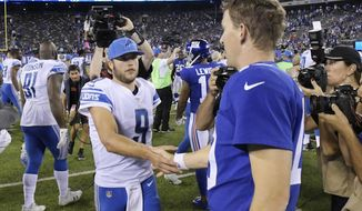 Detroit Lions quarterback Matt Stafford, left, shakes hands with New York Giants' Eli Manning after an NFL football game, Monday, Sept. 18, 2017, in East Rutherford, N.J. The Lions won 24-10. (AP Photo/Bill Kostroun)