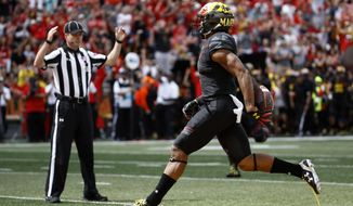 This Sept. 9, 2017 photo shows Maryland wide receiver D.J. Moore scoring a touchdown in the first half of an NCAA college football game against Towson in College Park, Md. Moore's knack for making big plays and scoring touchdowns explain why he's the focal point of the Maryland passing attack. He leads the Big Ten with an average of 115 yards receiving per game and has a catch in 23 straight games, longest streak at Maryland since Torrey Smith went 30 straight games from 2008-10. Moore is tied for seventh on the school career list with 12 TD catches. (AP Photo/Patrick Semansky)