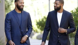 NBA players Markieff, left, and Marcus Morris arrive at Superior Court for the second day of their aggravated assault trial, Tuesday, Sept. 19, 2017, in Phoenix. The twins, along with Gerald Bowman, are charged with assaulting Erik Hood outside a recreation center in 2015 in Phoenix. (AP Photo/Matt York)