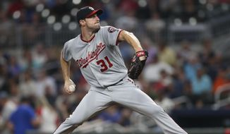 Washington Nationals starting pitcher Max Scherzer (31) works in the first inning of a baseball game against the Atlanta Braves Tuesday, Sept. 19, 2017, in Atlanta. (AP Photo/John Bazemore)