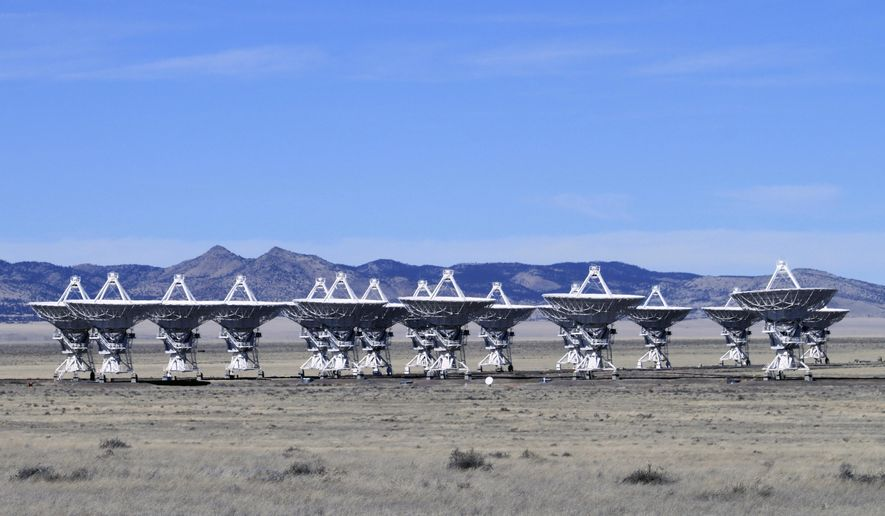 This Feb. 10, 2017 photo shows radio antennas that make up the Very Large Array astronomical observatory are positioned on tracks on the Plains of San Augustin west of Socorro, N.M. The Very Large Array is being used to make what astronomers say will be the sharpest radio image of a large swath of the sky as part of a 7-year project. (AP Photo/Susan Montoya Bryan)