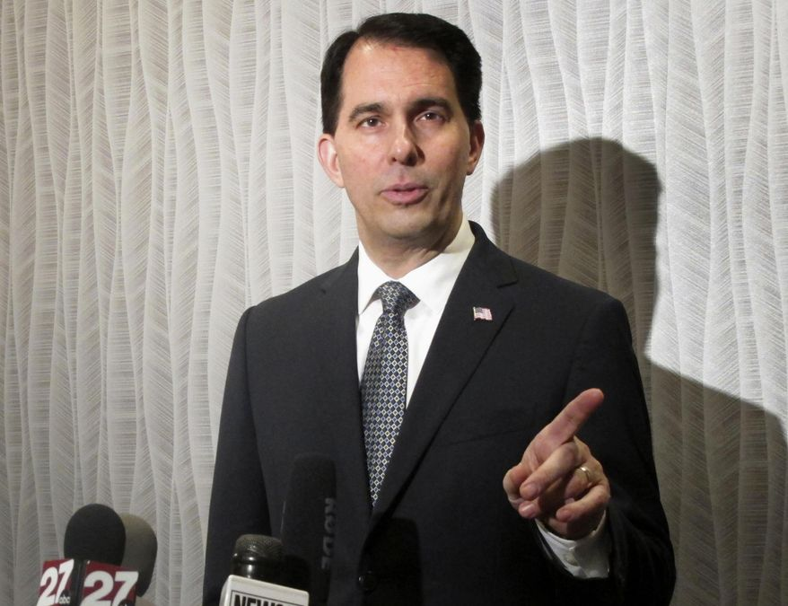 In a March 8, 2017, file photo, Wisconsin Gov. Scott Walker speaks at a news conference in Madison, Wis. (AP Photo/Scott Bauer, File)