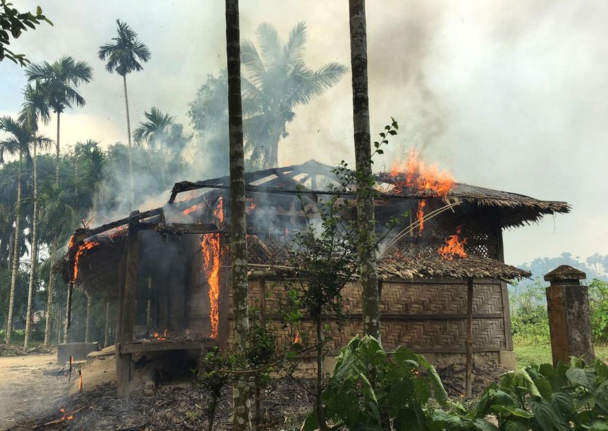 FILE - In this Sept. 7, 2017 file photo, flames engulf a house in Gawdu Zara village, northern Rakhine state, Myanmar. Security forces and allied mobs have burned down thousands of homes in Northern Rakhine state, where the vast majority of the country's 1.1 million Rohingya lived, in recent weeks. (AP Photo, File)