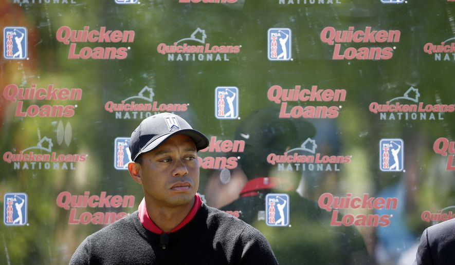 FILE - In this May 16, 2016, file photo, Tiger Woods pauses during a Quicken Loans National golf tournament media availability on the 10th tee at Congressional Country Club in Bethesda, Md. The tournament that Woods launched 10 years ago remained on next season's PGA Tour schedule. Still to be determined is where,  and if, it is held. The tour has opted out of its contract with Congressional next year as it tries to find a title sponsor. (AP Photo/Alex Brandon, File)