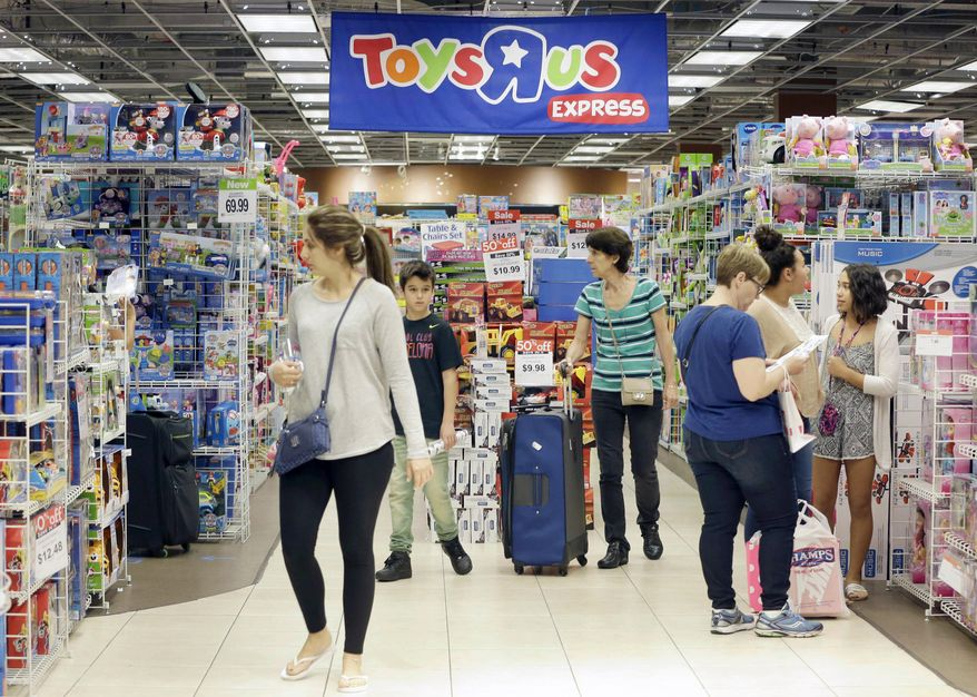 In this Friday, Nov. 25, 2016, file photo, shoppers shop in a Toys R Us store on Black Friday in Miami. Toys R Us, the pioneering big box toy retailer, announced late Monday, Sept. 18, 2017, it has filed for Chapter 11 bankruptcy protection while continuing with normal business operations. (AP Photo/Alan Diaz, File)