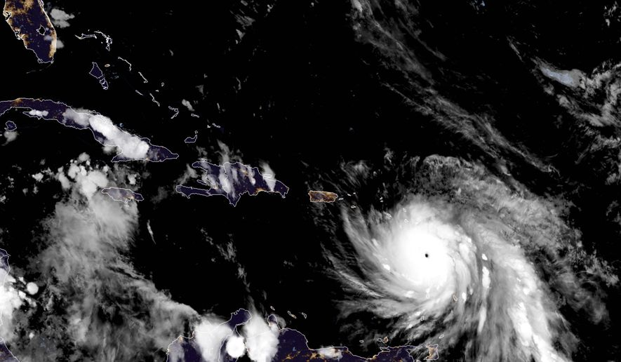 This Monday, Sept. 18, 2017, GOES East satellite image provided by NASA taken at 23:15 UTC, shows the eye of Hurricane Maria as it nears Dominica. The National Hurricane Center in Miami said Monday evening that Air Force Reserve hurricane hunter planes found that Maria had strengthened into a storm with 160 mph (260 kph) winds. (NASA via AP)
