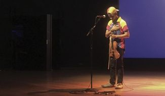 Venezuelan musician Wuilly Arteaga thanks the audience after playing the violin at the Alice Tully Hall in New York's Lincoln Center, Tuesday Sept. 19, 2017. Arteaga is a well-known face of protest against his country's socialist government. He told the Associated Press on Tuesday that if he finds a job in the U.S. he will probably seek asylum. (AP Photo/Claudia Torrens)