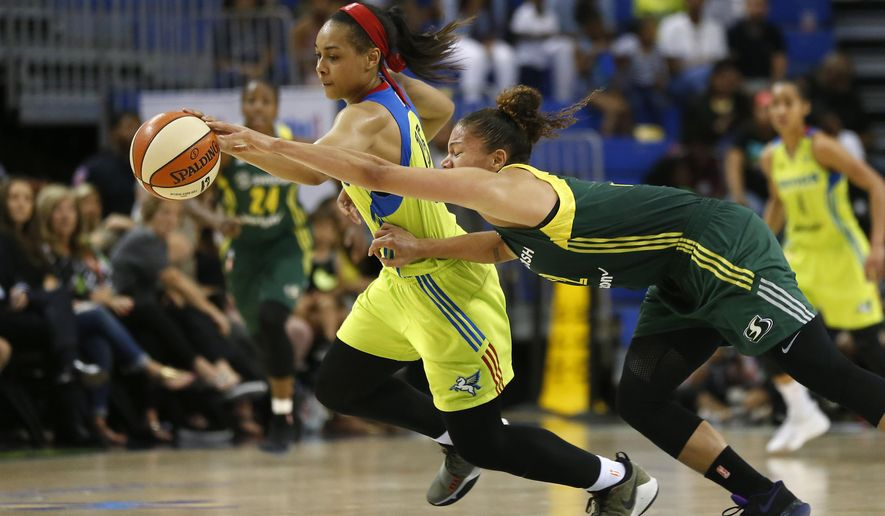 FILE - In this July 1, 2017, file photo, Dallas Wings guard Allisha Gray (15), rear left,  gets a loose ball against Seattle Storm forward Alysha Clark during the second half of a WNBA basketball game in Arlington, Texas. Dallas Wings guard Allisha Gray is the WNBA Rookie of the Year. The league announced Tuesday, Sept. 19, 2017, that Gray received 30 votes from a national media panel while Atlanta Dream guard Brittney Sykes got 10.  (Jae S. Lee/The Dallas Morning News via AP, File)