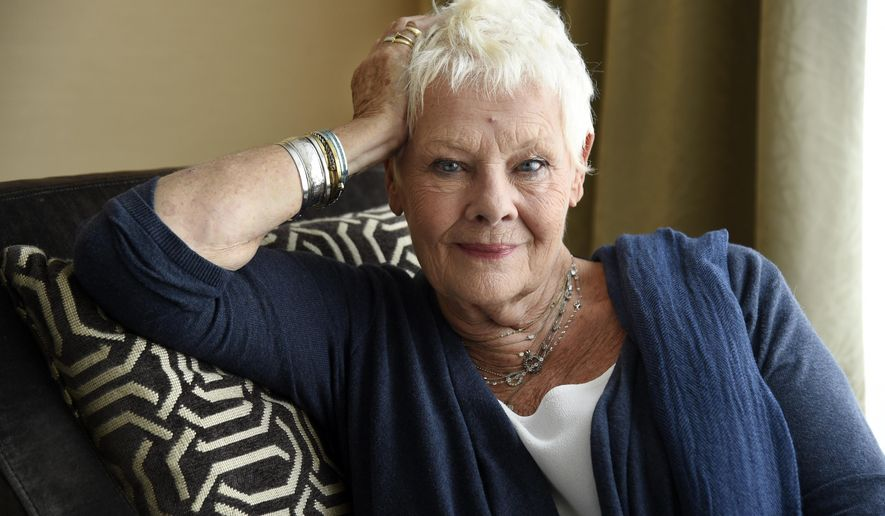 """In this Sept. 11, 2017 photo, Judi Dench, a cast member in the film """"Victoria and Abdul,"""" poses for a portrait during the Toronto International Film Festival in Toronto. (Photo by Chris Pizzello/Invision/AP)"""
