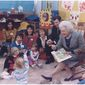 "Then-first lady Barbara Bush and then-Missouri Gov. John Ashcroft attend a ""Parents as Teachers"" event in Florissant, Missouri, where Mrs. Bush reads to the children. (National Archives)"