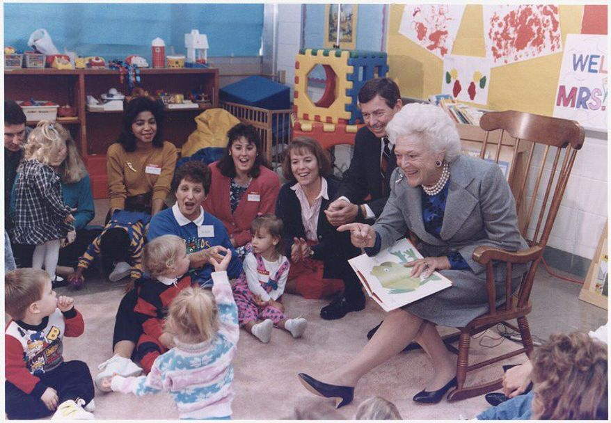 """Then-first lady Barbara Bush and then-Missouri Gov. John Ashcroft attend a """"Parents as Teachers"""" event in Florissant, Missouri, where Mrs. Bush reads to the children. (National Archives)"""