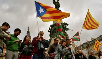"Independence supporters wave ""estelada"" flags during a rally in northern Spain. (Associated Press/File)"