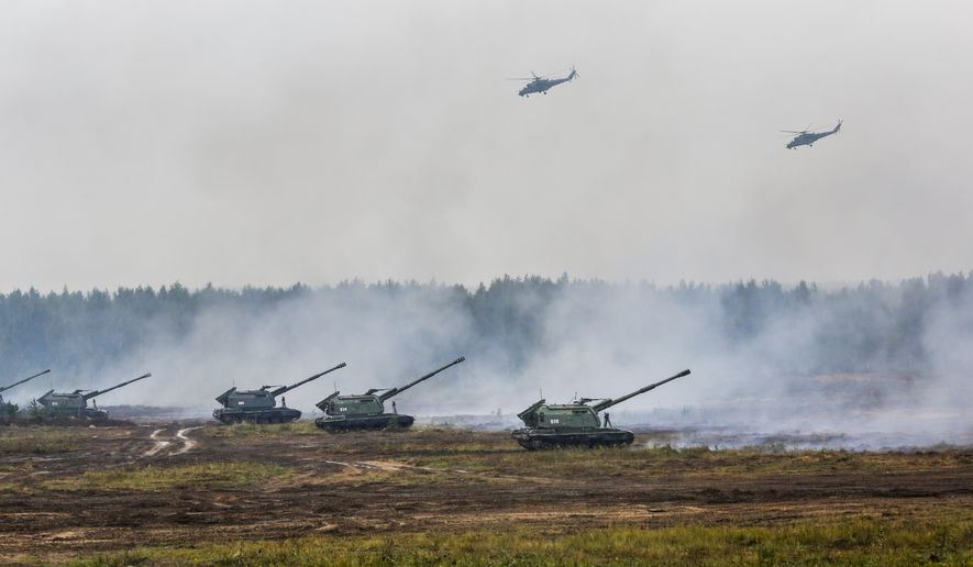 Belarusian and Russian troops take part in the Zapad (West) 2017 Russia-Belarus military exercises at the Borisovsky range in Borisov, Belarus, Wednesday, Sept. 20, 2017. (AP Photo/Sergei Grits)