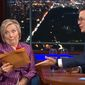 "Former Secretary of State Hillary Clinton reacts on Sept. 19, 2017, as she is presented with unused jokes from Stephen Colbert's 2016 election special on Showtime. (Image: YouTube, ""The Late Show with Stephen Colbert"")"