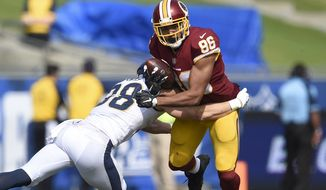 Washington Redskins tight end Jordan Reed (86) in action defended by Los Angeles Rams safety Cody Davis (38) during the second half of an NFL football game Sunday, Sept. 17, 2017, in Los Angeles. (AP Photo/Kelvin Kuo)