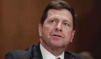 In this March 23, 2017, file photo, then-Securities and Exchange Commission (SEC) Chairman nominee Jay Clayton testifies on Capitol Hill in Washington at his confirmation hearing before the Senate Banking Committee. (AP Photo/Pablo Martinez Monsivais, File)