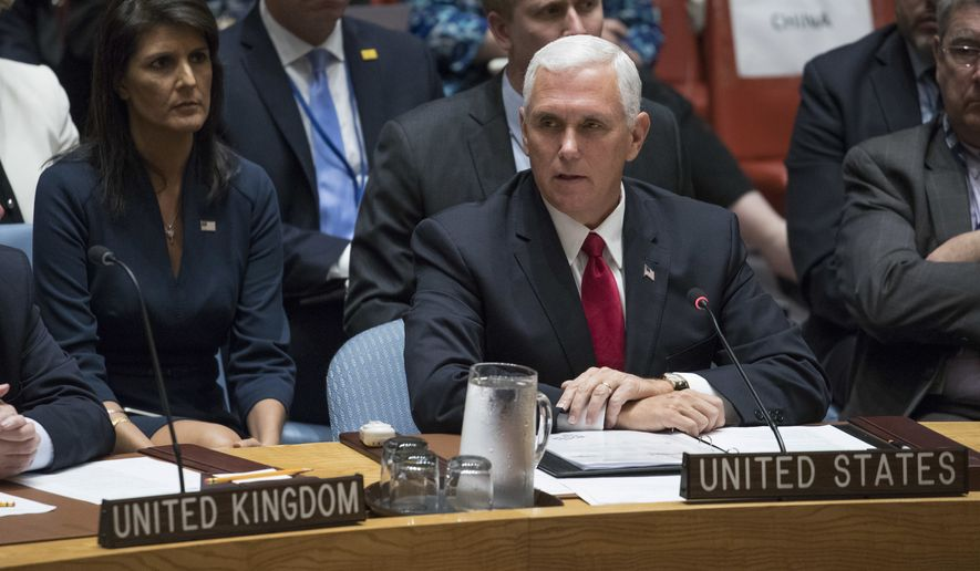 U.S. Ambassador to the United Nations Nikki Haley, left, listens as Vice President Mike Pence speaks during a high level Security Council meeting on United Nations peacekeeping operations, Wednesday, Sept. 20, 2017 at U.N. headquarters. (AP Photo/Mary Altaffer)