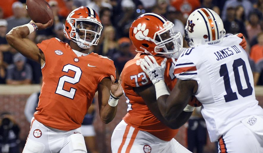 FILE - In this Saturday, Sept. 9, 2017, file phot, Clemson quarterback Kelly Bryant (2) throws a pass against Auburn during the first half of an NCAA college football game in Clemson, S.C. Not every school can be like No. 2 Clemson, which is going for a second straight national championship despite replacing two-time Heisman Trophy finalist Deshaun Watson at quarterback.  (AP Photo/Rainier Ehrhardt, File)