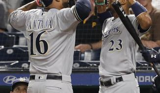 Milwaukee Brewers' Domingo Santana (16) celebrates with Keon Broxton (23) after hitting a solo home run off Pittsburgh Pirates starting pitcher Steven Brault in the third inning of a baseball game, Wednesday, Sept. 20, 2017 in Pittsburgh. (AP Photo/Gene J. Puskar)