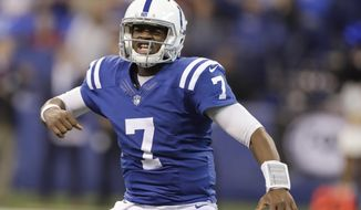 Indianapolis Colts quarterback Jacoby Brissett celebrates after a five-yard touchdown run by running back Frank Gore during the first half of an NFL football game against the Arizona Cardinals, Sunday, Sept. 17, 2017, in Indianapolis. (AP Photo/Darron Cummings)