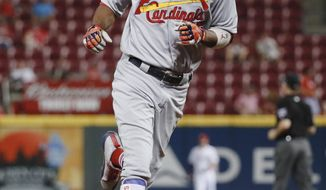 St. Louis Cardinals' Dexter Fowler runs the bases after hitting a two-run home run off Cincinnati Reds starting pitcher Rookie Davis in the third inning of a baseball game, Wednesday, Sept. 20, 2017, in Cincinnati. (AP Photo/John Minchillo)